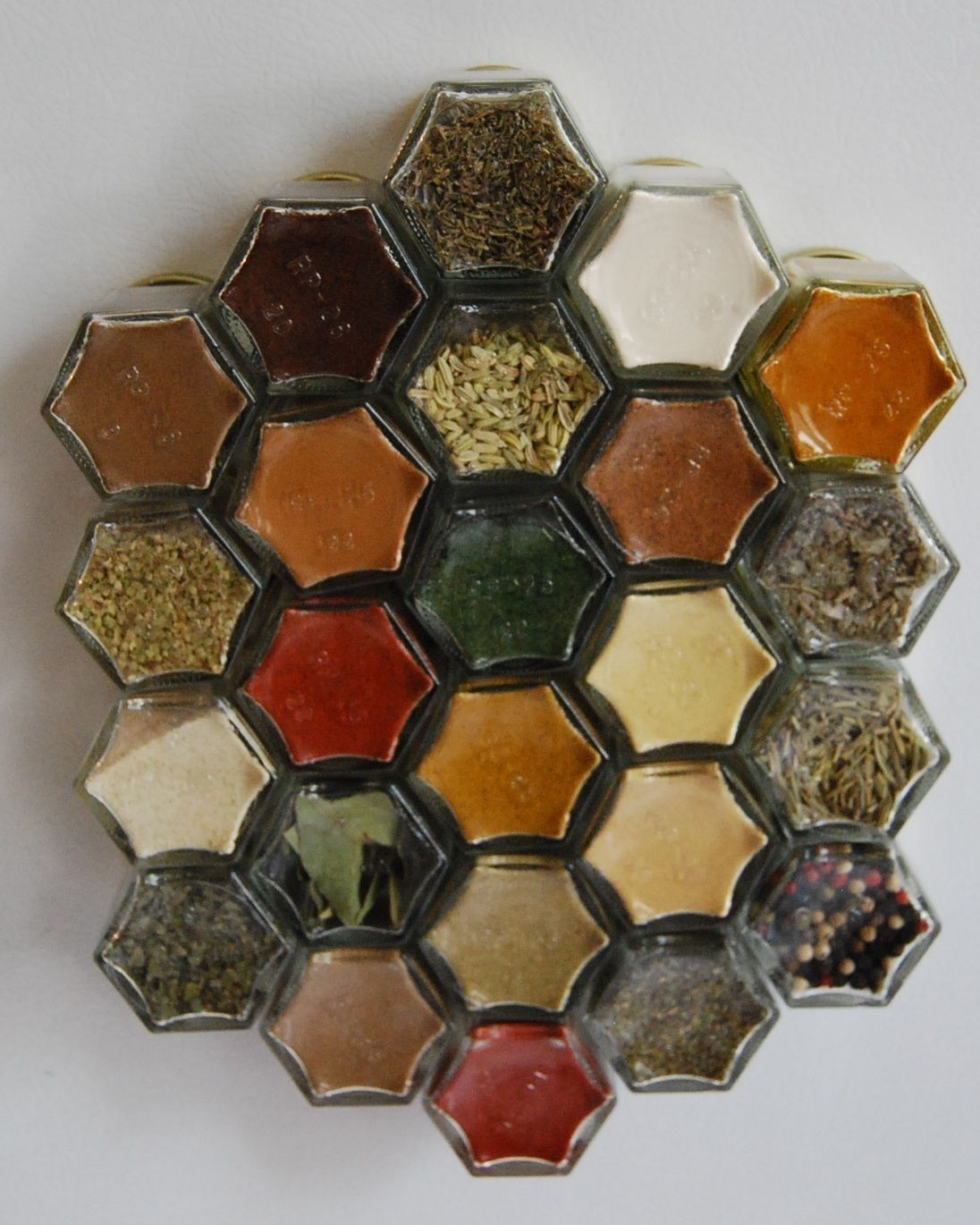Magnetic Spice Rack for Compact Living (set of 24 empty EMBOSSED jars). Free Shipping.. $100.00, via Etsy.