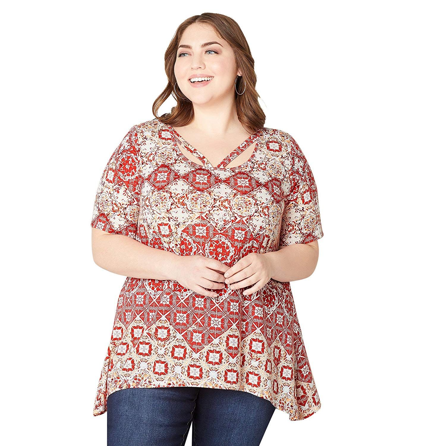 aeda9fa618c9f7 Avenue Women s Geo Medallion Sharkbite Top. This trendy top has a  curve-complimenting sharkbite hem and trendy caged details at the neckline.