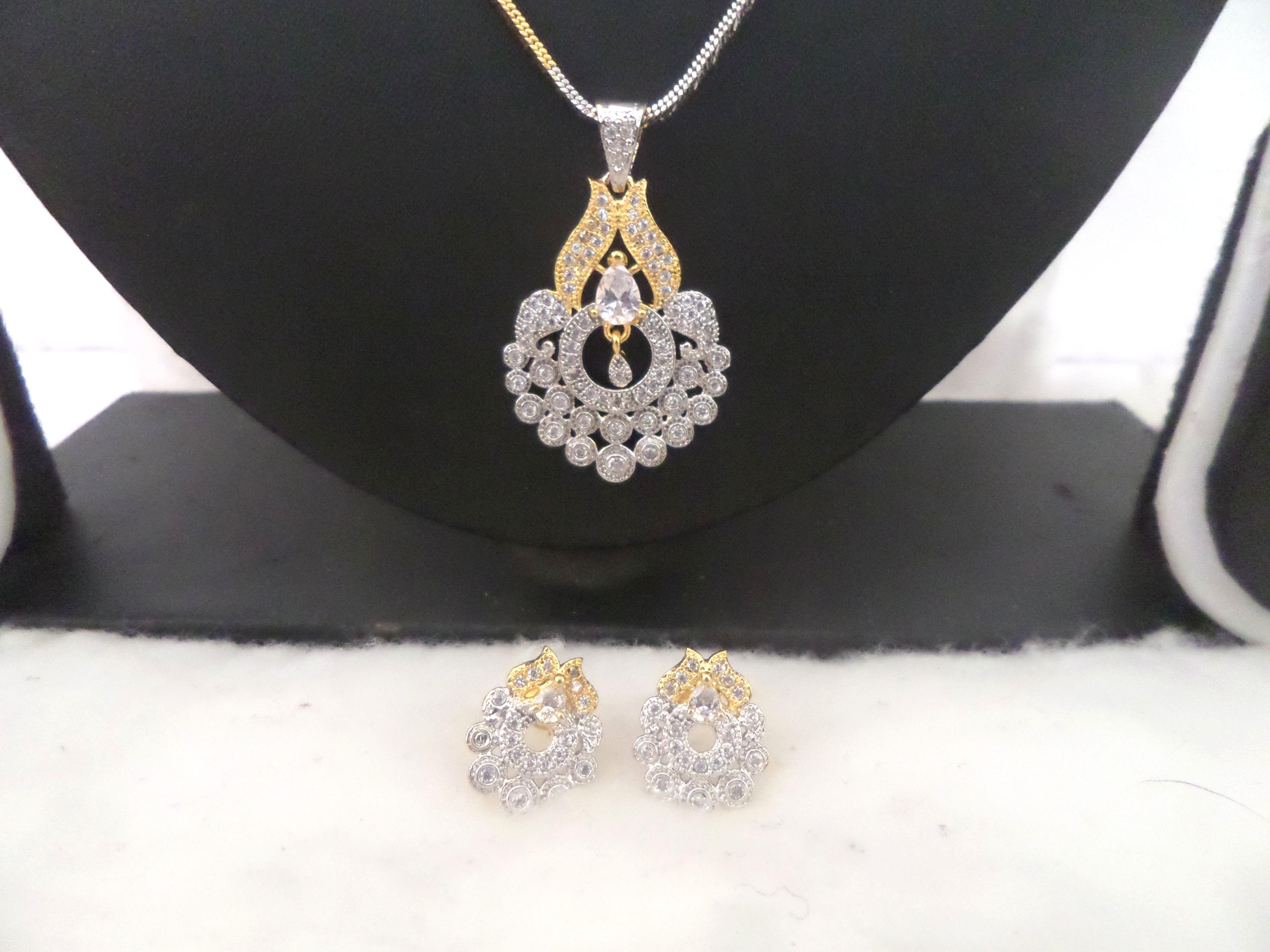 Latest cz white gold designer pendant earrings set shourya exports
