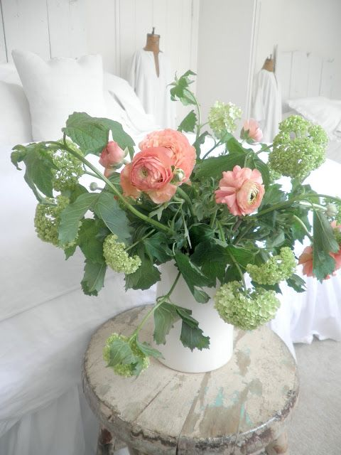 A small vase of flowers.... In the guests room and the ...