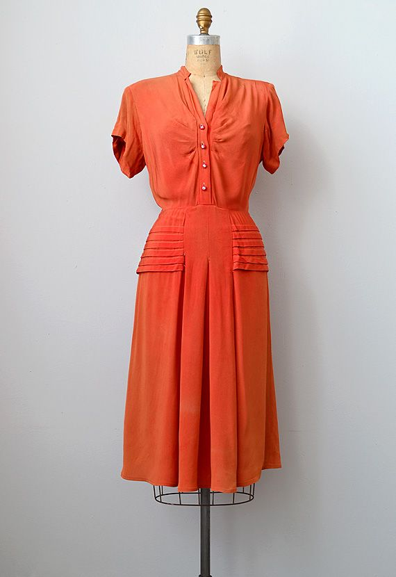 1940s burnt orange button-up dress. Oooh that hip detail ...