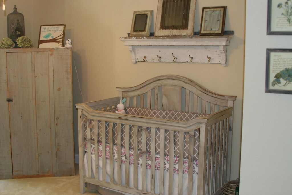 rustic baby crib with gray closet and