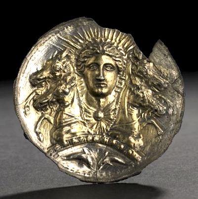 Silver-gilt disc, probably a horse-phalera, embossed with the head of Helios  with two horses each side;  Greek 5thC BC- 2ndC BC