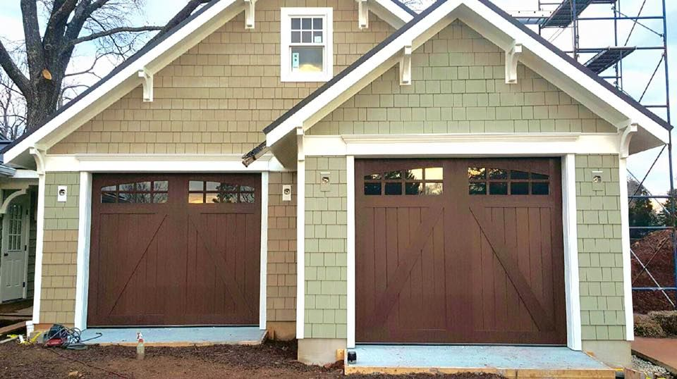 These Carriage House Garage Doors Look Like Real Wood But Are Actually A Stainable Faux Wood Compos Faux Wood Garage Door Garage Door Styles Garage Door Design