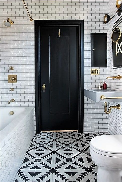 Absolutely love the tile floor in this bathroom. By Katie Martinez Design.