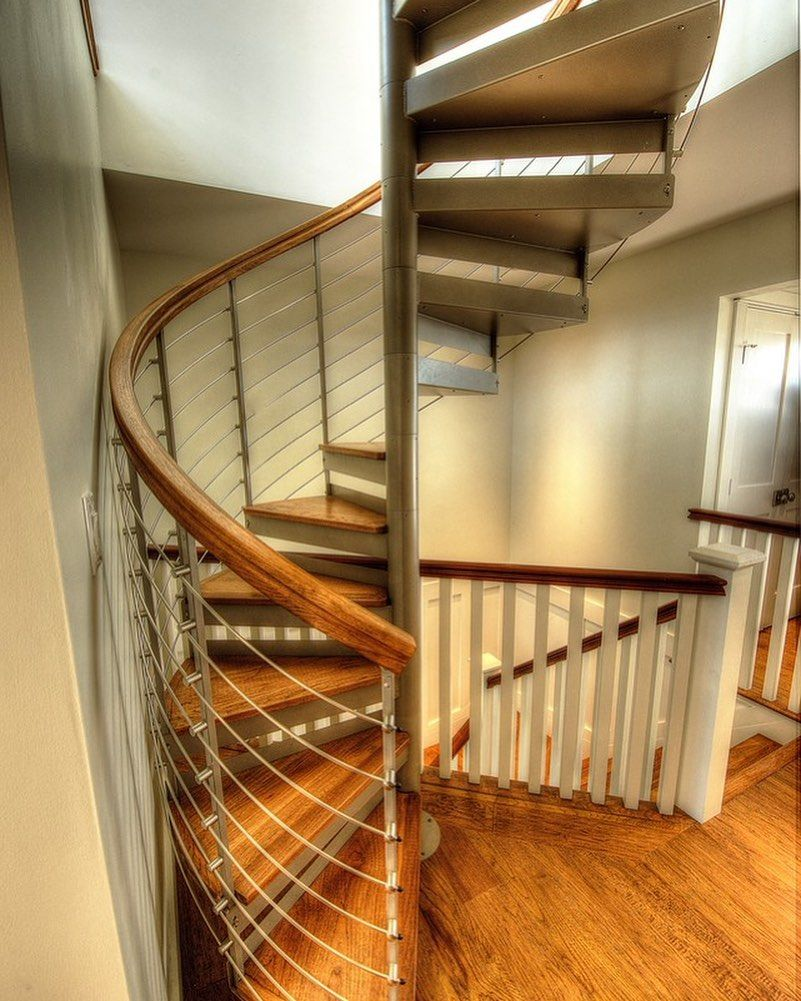 A spiral staircase can transform and tie together any space.  #spiralstairs #spi…