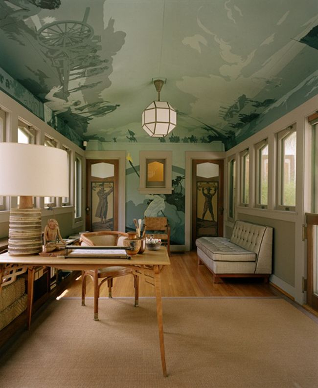 A paint-by-number-esque mural covers walls and ceiling in this home office designed by William Sofield.