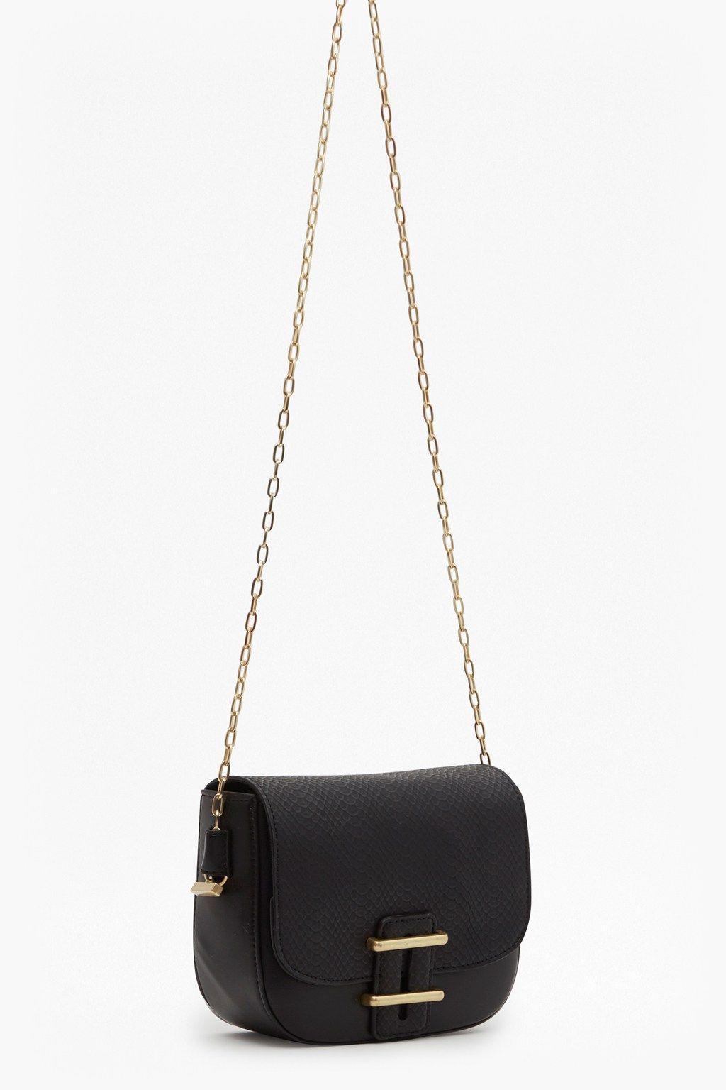 <ul> <li> Faux leather handbag</li> <li> Contrast snake-effect flap</li> <li> Front flap with side lock</li> <li> Chain strap</li> <li> Gold hardware</li> </ul>