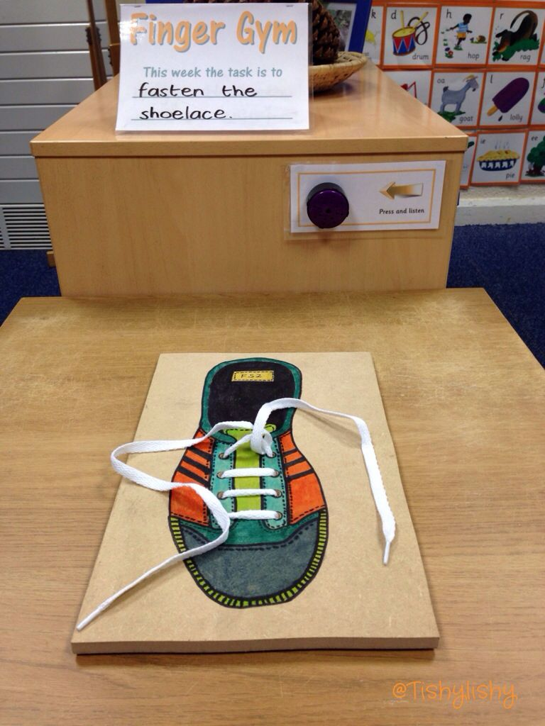 Finger Gym -Picture of tie your shoelace board.-There are drilled holes in the wood with the lace threaded through.