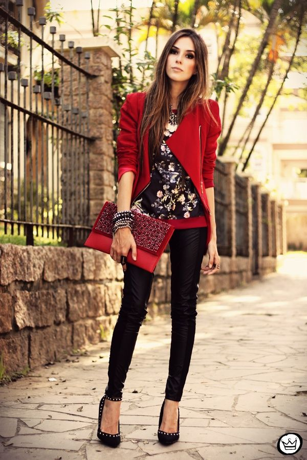 red stylish coat pants with purse and floral shirt