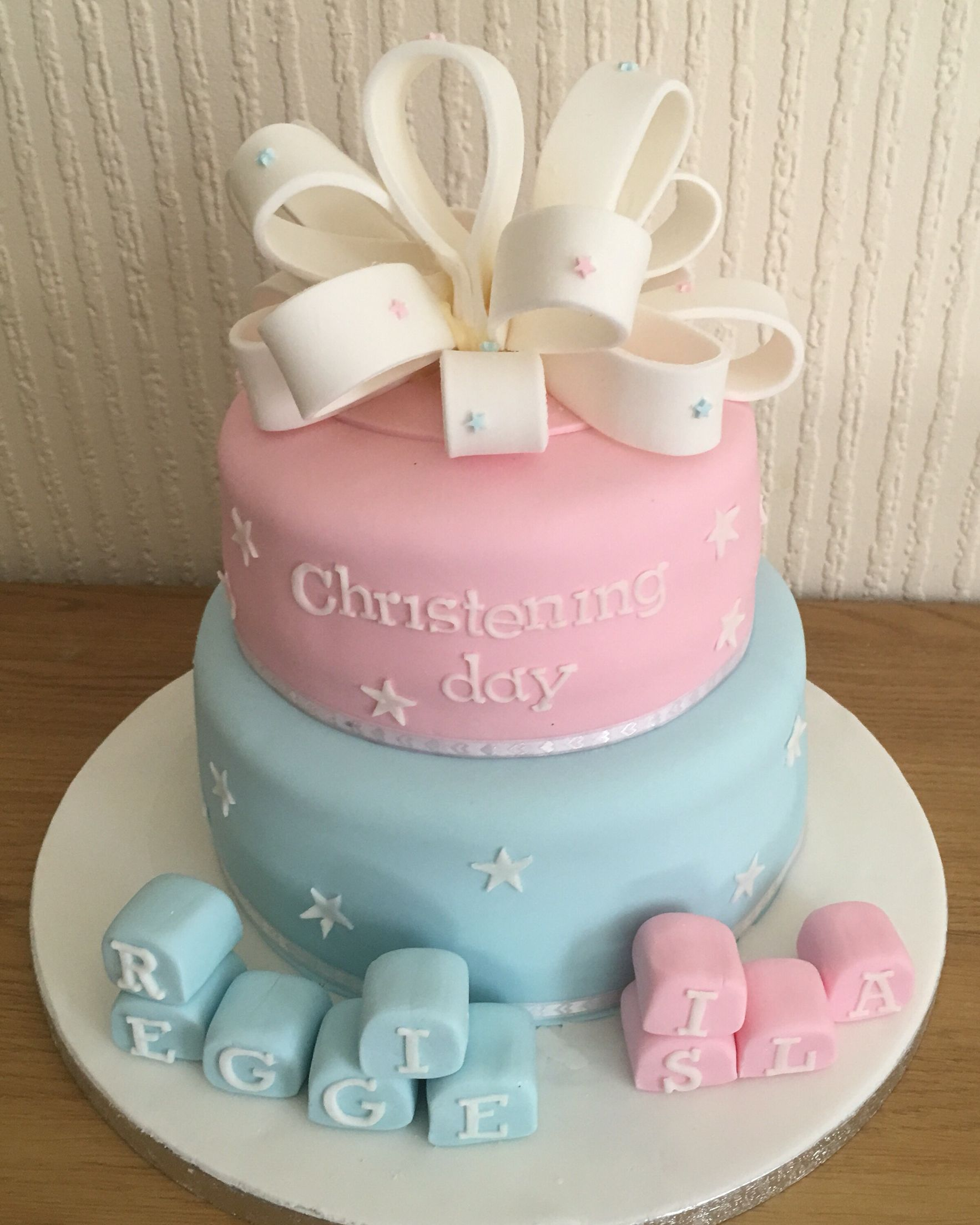 Christening cake made for twin brother and sister so it s baby