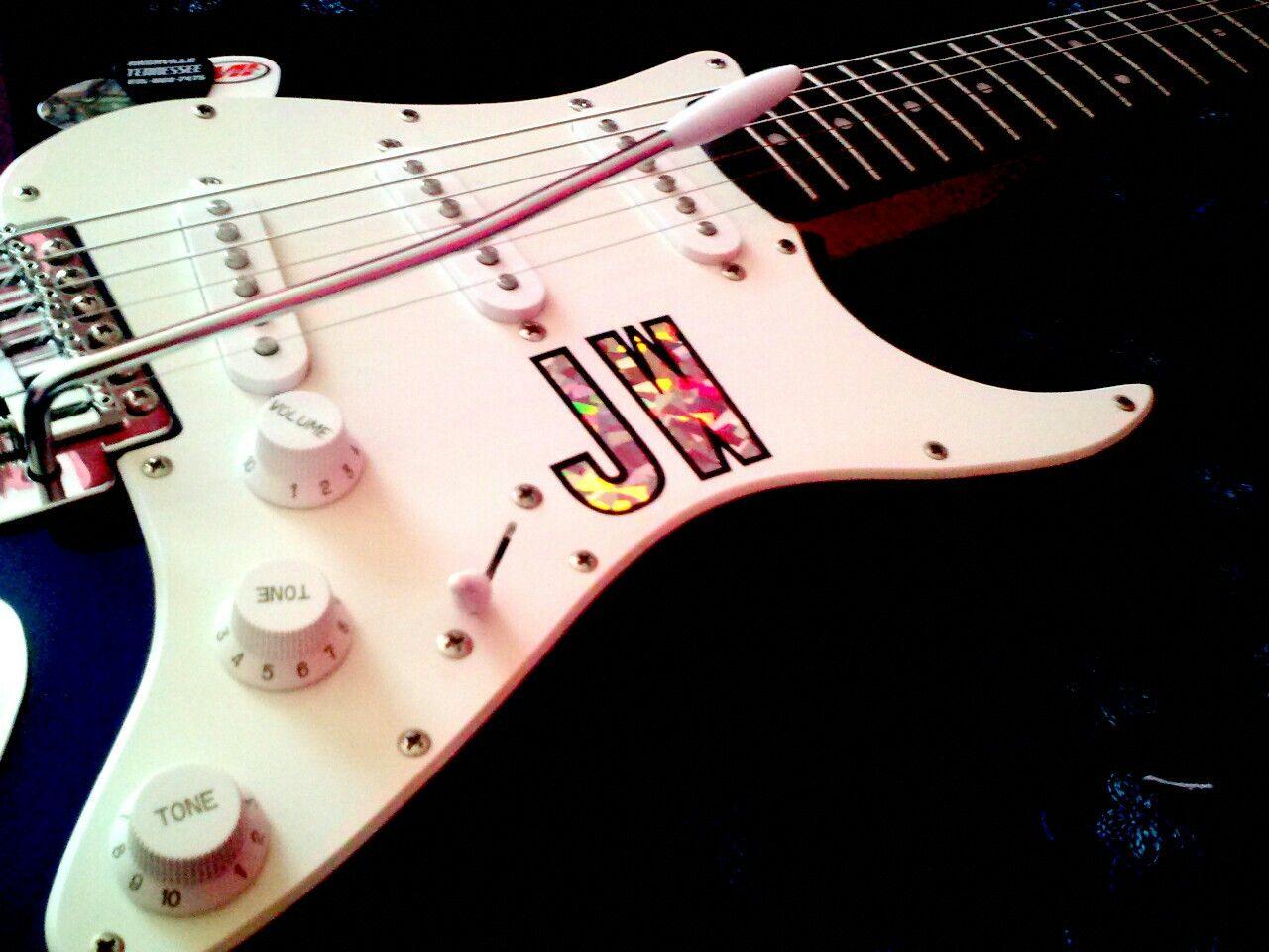 The Fender Strat: Blue Boy. Added my initials,  JW .