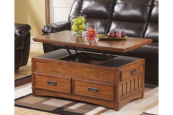 The Cross Island Lift Top Coffee Table From Ashley Furniture