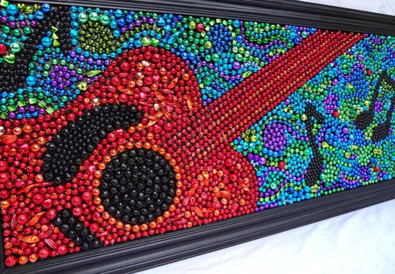 Mosaic from Marti Gras beads by Bayouland Beads via Etsy.