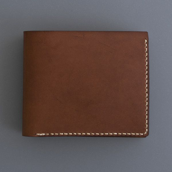 Hand crafted in a small workshop in London. The vegetable tanned leather will acquire a rich patina with use. Each wallet is skilfully hand stitched with a strong waxed linen thread.
