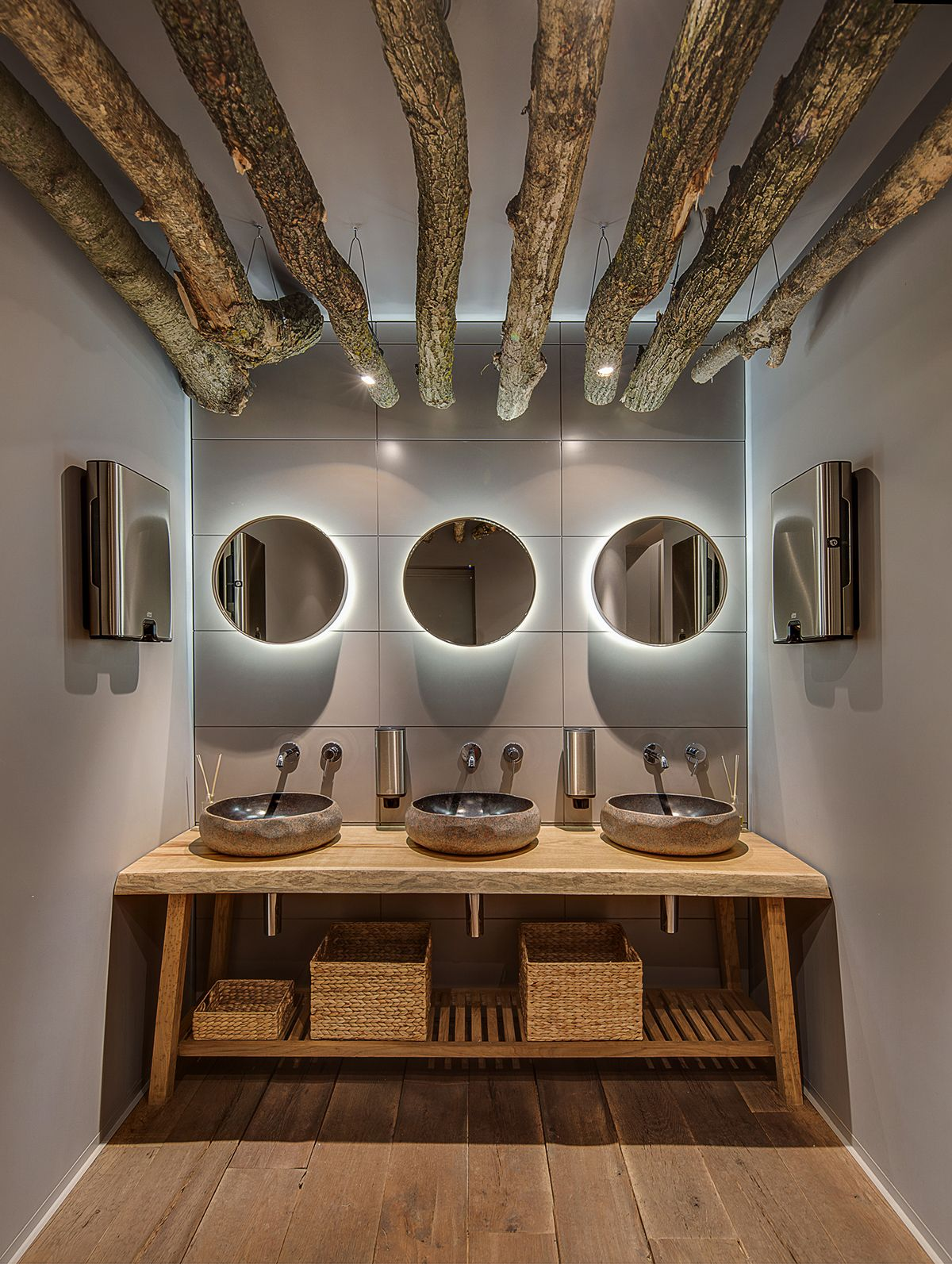 BARVY restaurant mixes warm wood with cool grey in their restroom
