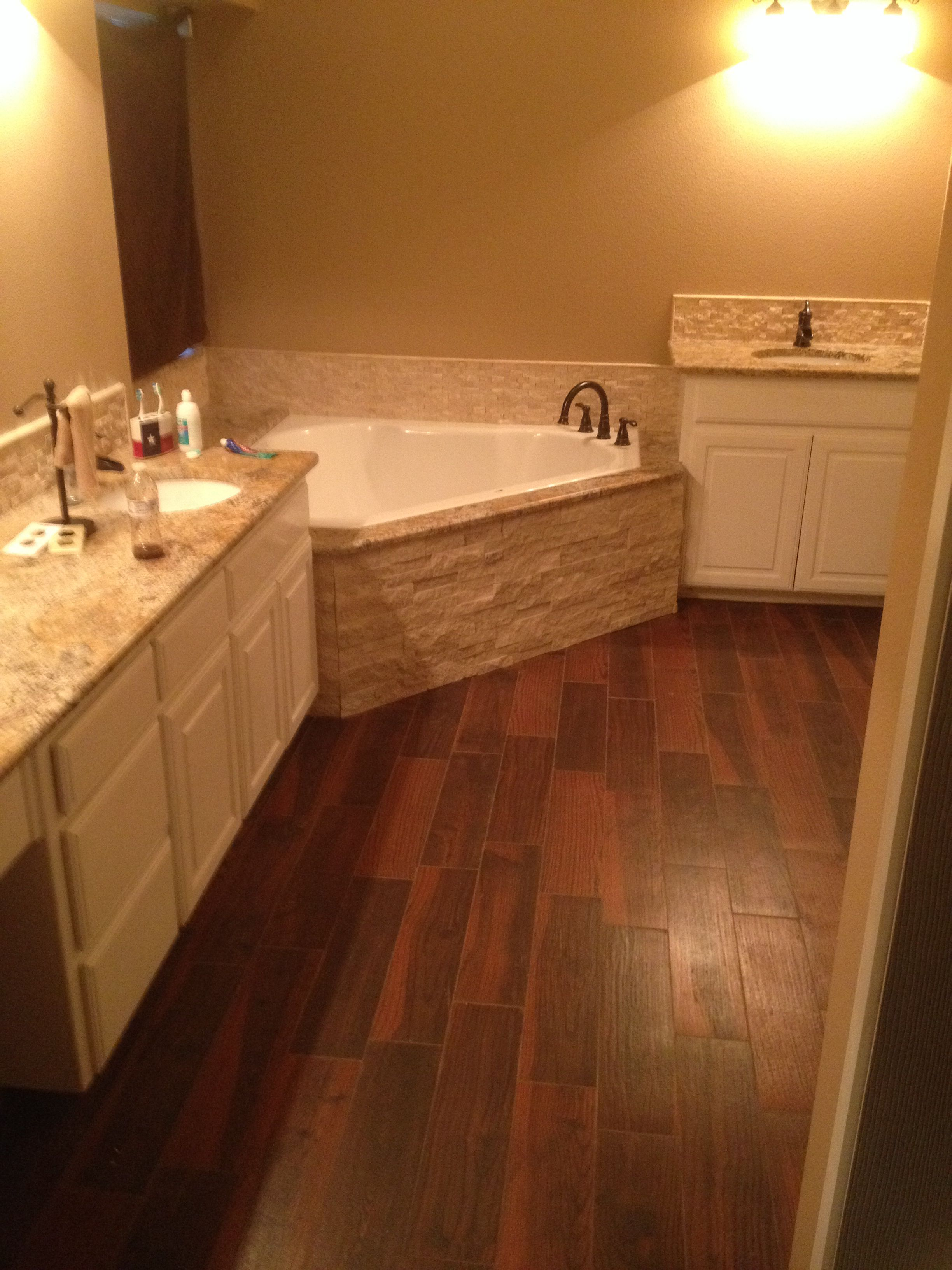 Bathroom remodel - not sold on stones on tub....but LOVE the floor
