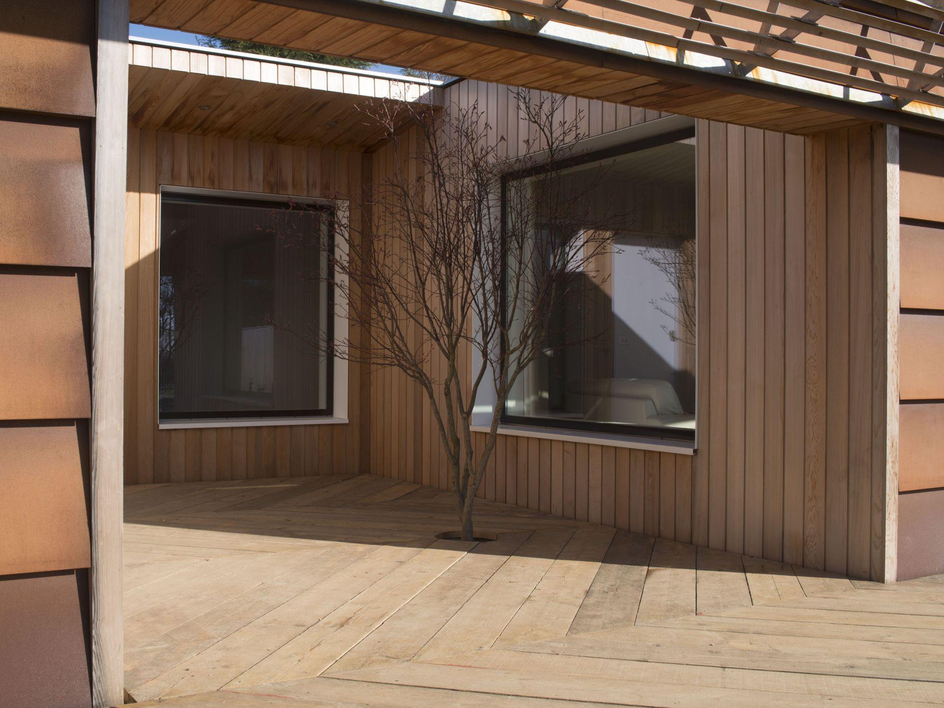 Corten staal met houten planken mooie gevel bekleding architecture pinterest houten - Architectuur staal corten ...