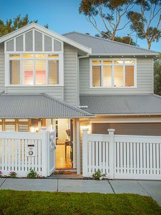This stunning double story modern weatherboard home on a - Modern weatherboard home designs ...