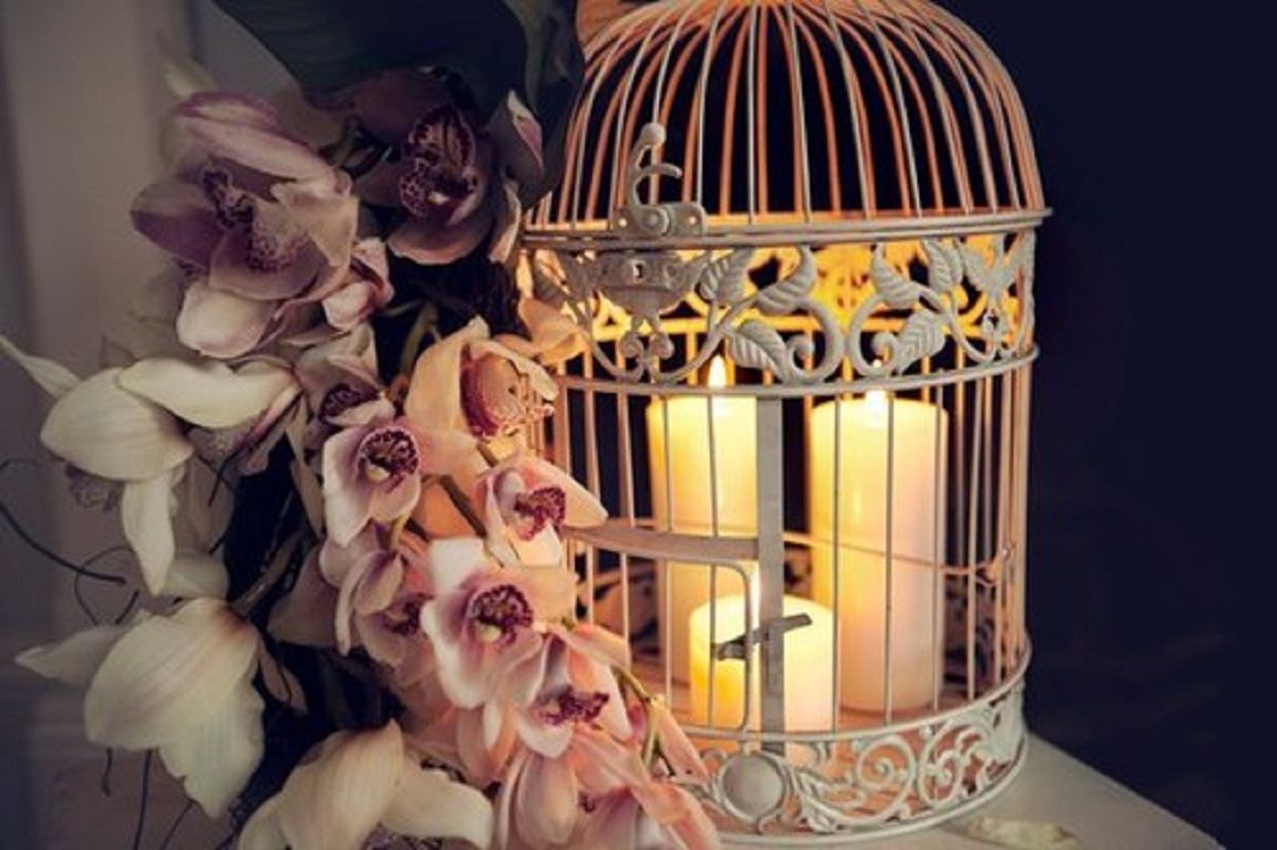 candles in a wedding cage