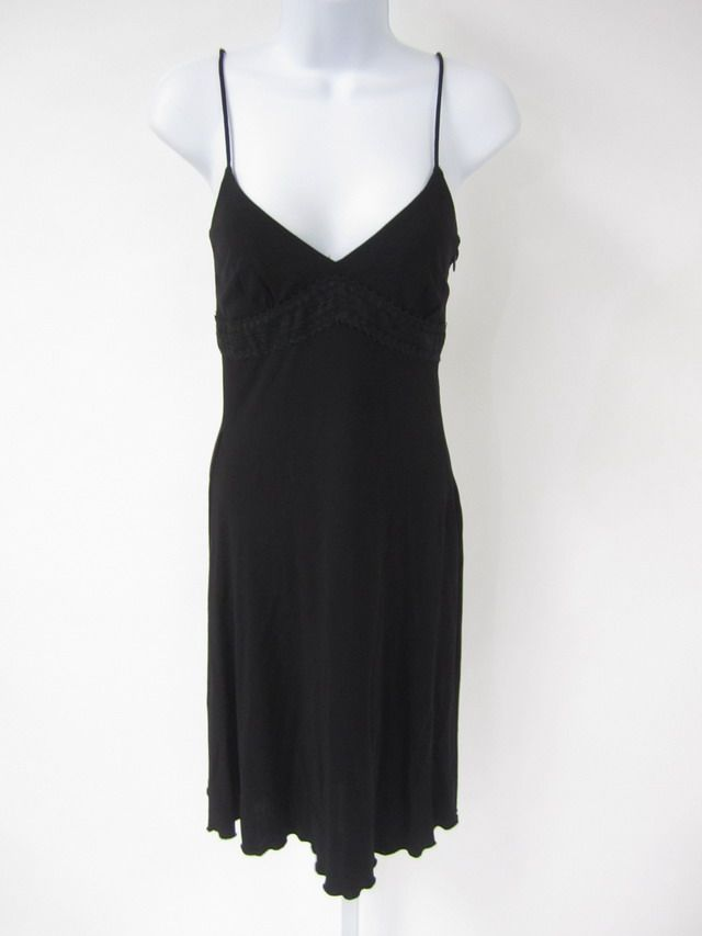 1990s black slip dress- i spent every friday evening in a slip like this, layered on top of a white one :) complete with combat boots and tons of eyeliner- this was my high school experience.