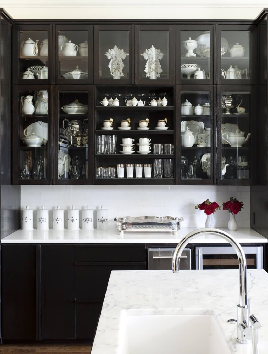 Captivating Black Kitchen Cabinets With Glass Doors And White Marble Counters Filled With Household G Black Kitchen Cabinets Dark Kitchen Cabinets Dark Kitchen