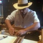John Anetrella, rolling cigars.