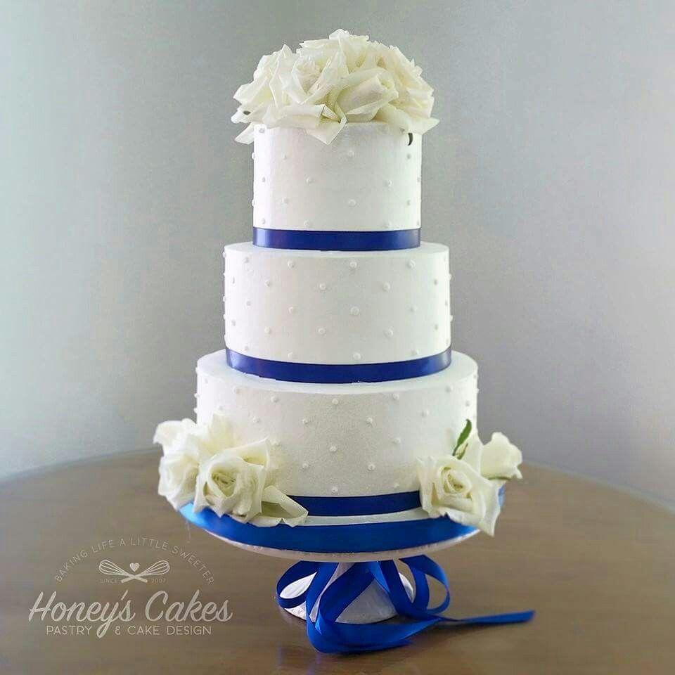 Wedding decoration ideas blue and white  Simply elegant white Buttercream wedding cake with fresh roses and