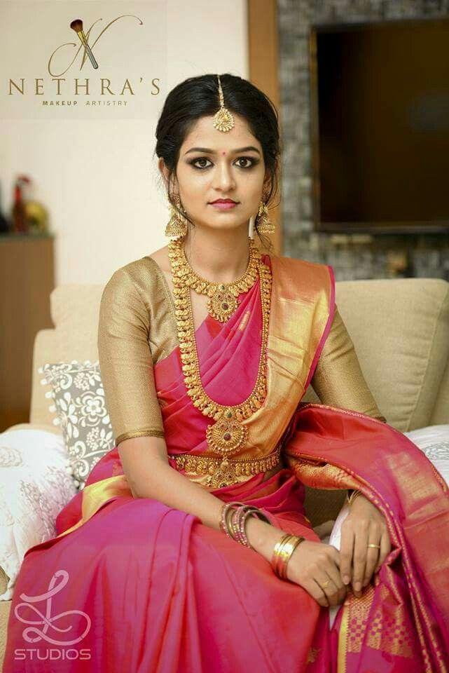 South Indian bride. Gold Indian bridal jewelry.Temple jewelry. Jhumkis.Pink silk kanchipuram sari.Braid with fresh jasmine flowers. Tamil bride. Telugu bride. Kannada bride. Hindu bride. Malayalee bride.Kerala bride.South Indian wedding. Pinterest: @deepa8
