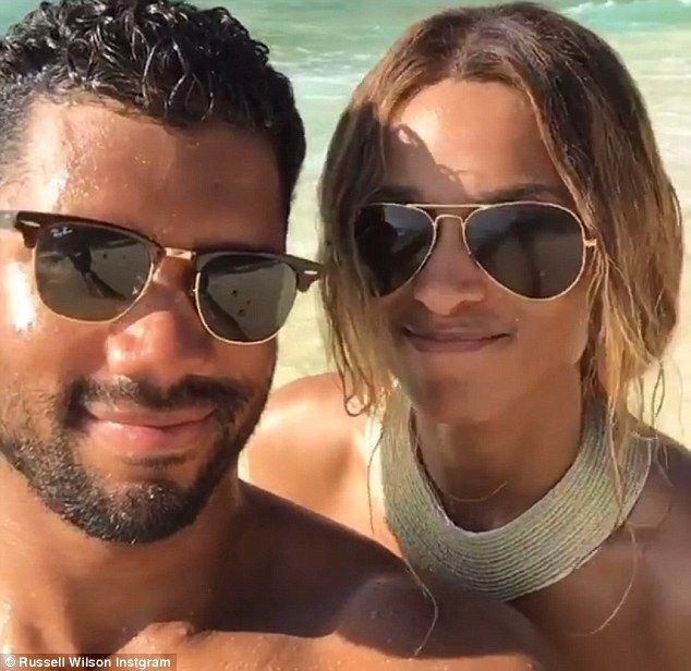 Quite the pair: The gorgeous duo showed off wide smiles in the video, in which they could be seen standing in front of a scenic, ocean background