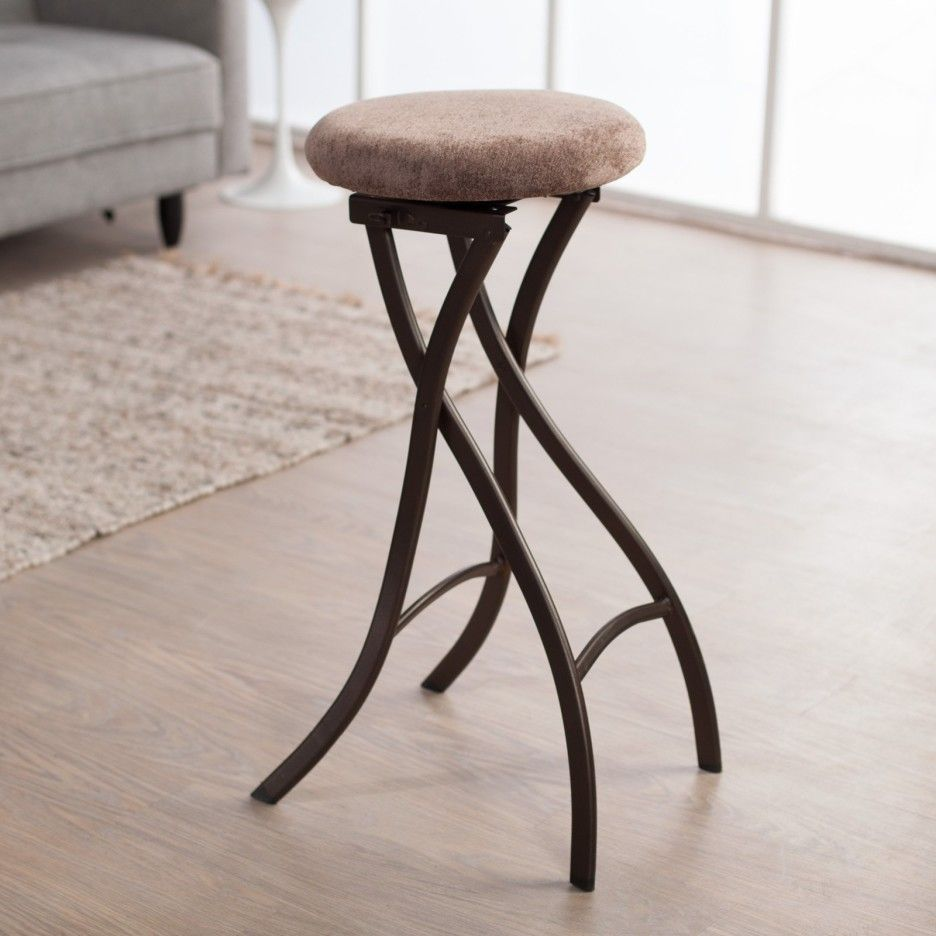 Furniture. brown polished wrought iron bar stool with round saddle ...