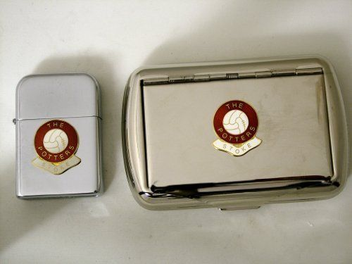 Football Club Lighters-Stoke 'The Potters' Football Club Petrol Storm Proof Lighter & Tobacco Tin by Football Club Lighters. $29.99. A high quality storm proof refillable petrol lighter & Tobacco tin. The lighter has been manufactured to give years of service and is very similar to the famous branded lighter. Tobacco tin has built in paper holder both are decorated with a high quality English made Enamel Football Club Badge. Be the envy of all your friends wit...