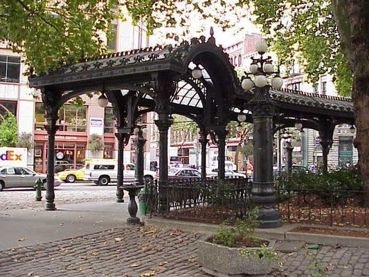 Pioneer Square   In historic Pioneer Square, seek natural refuge in the shady courtyard of Waterfall Garden Park (S. Main St. and Second Ave. S.), with a waterfall cascading 22 feet (6.7 meters) over granite boulders into a tranquil Japanese pool below.