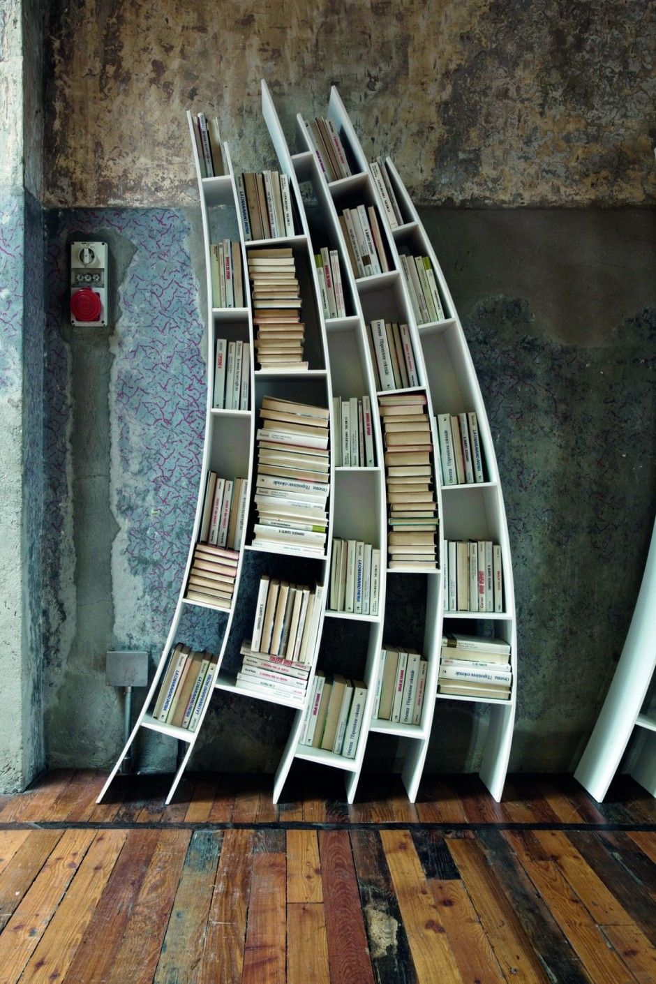 From Italian furniture house Saba... sweeping bookcase design ...