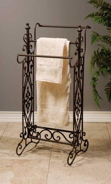 Traditional Narrow Wrought Iron Quilt Or Towel Rack In A Dark