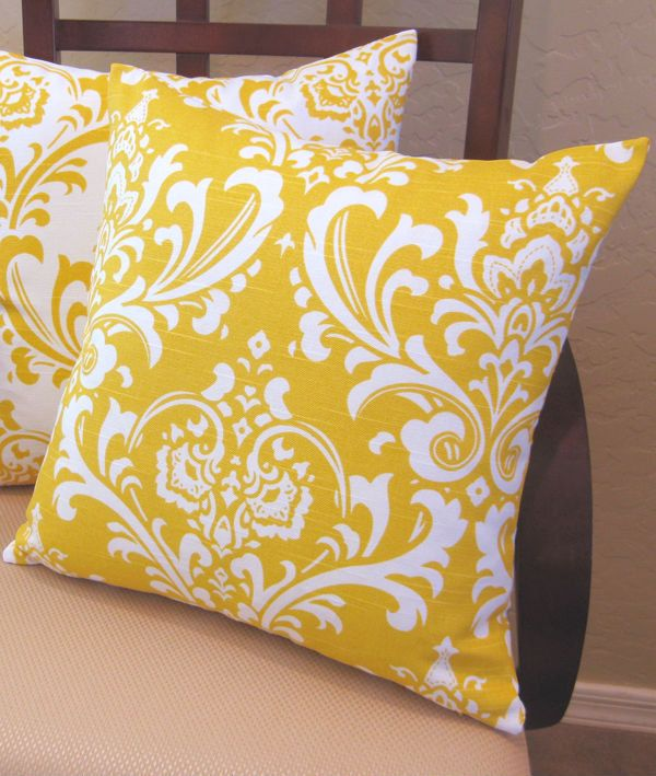 Im going to cover my bed in a MILLION fun pillows!! Ornate White on Yellow Damask Pattern Throw Pillow Cover. $15.95, via Etsy.