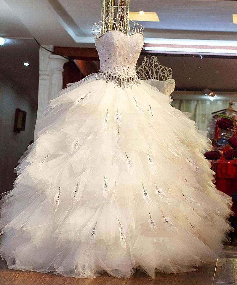 Robe mariee avec plumes
