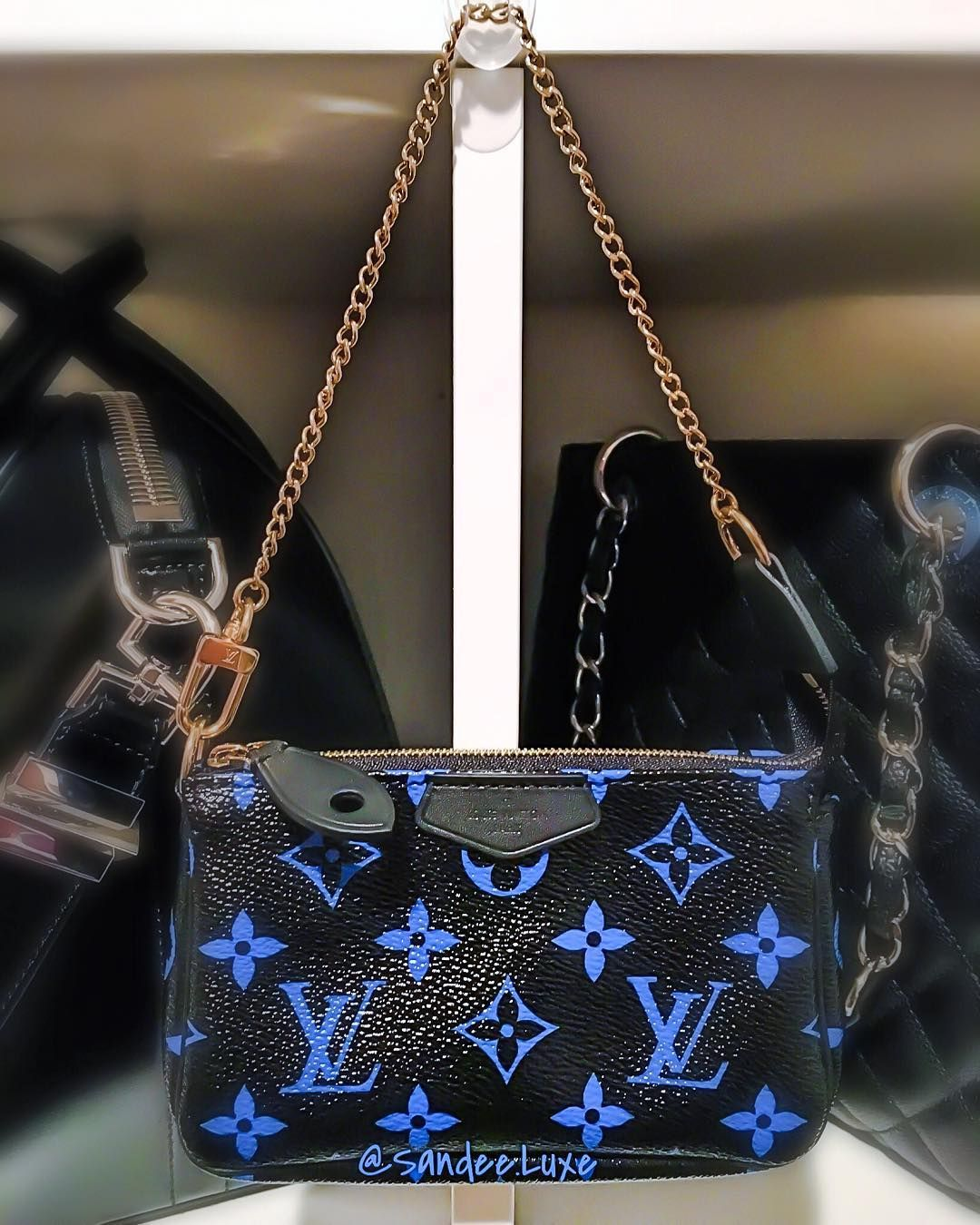 €300 Louis Vuitton Mini Pochette blue monogram from the new collection SS16 black and blue combination and black velvet interior with gold hardware
