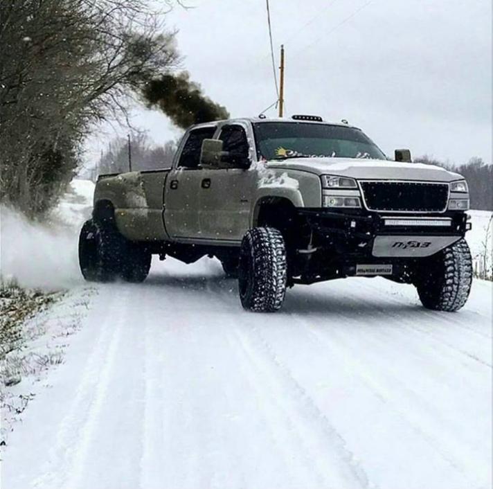Duramax diesel chevy Silverado rolling coal in snow