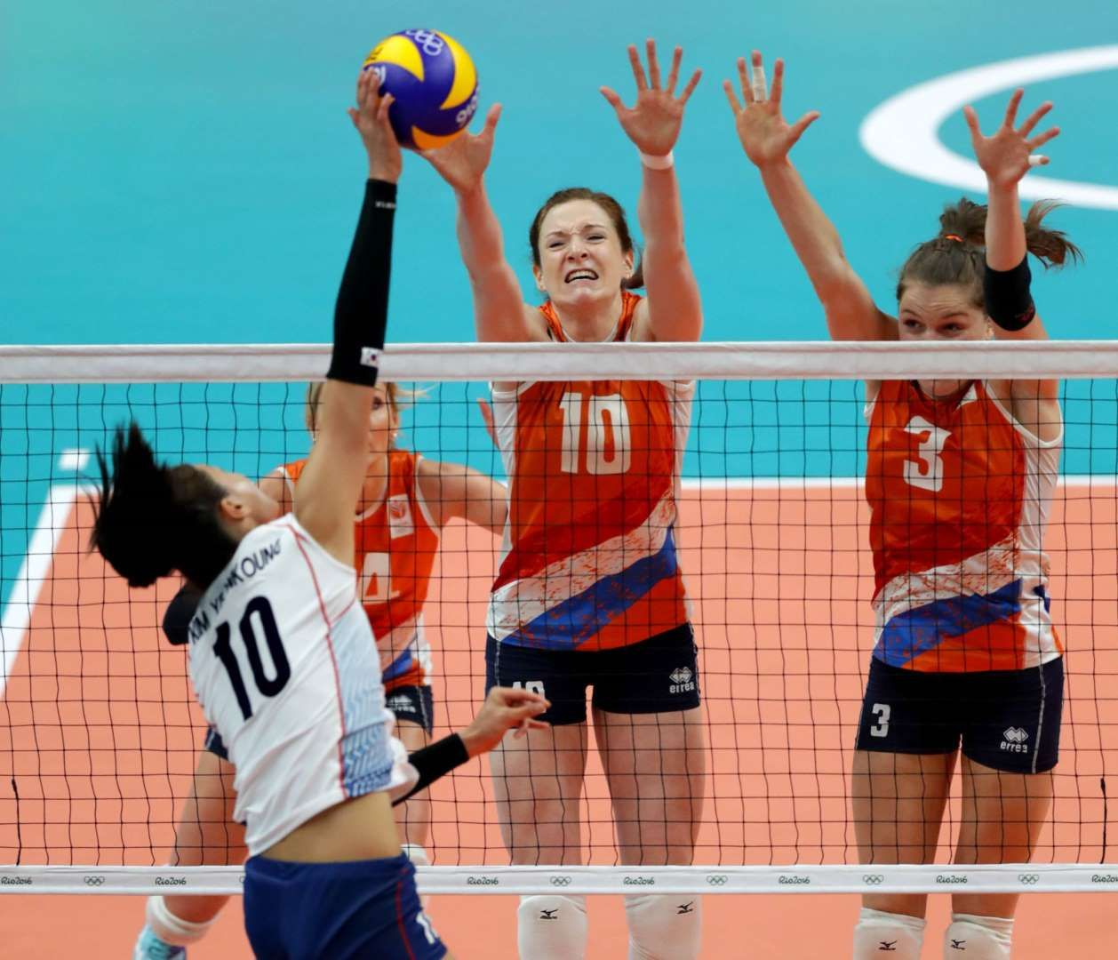 Yeon Koung Kim Of South Korea Spikes The Ball As Netherlands Attempts To Block During A Women S Volleyball Match Bet Rio Olympics Summer Olympic Games Olympics
