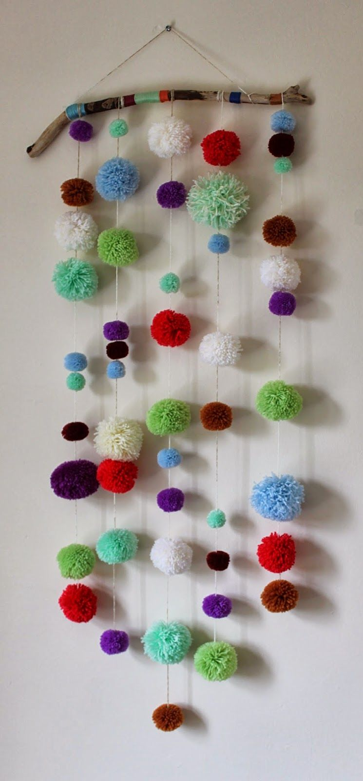diy driftwood pom pom wall hanging would love to make one for the succah or maybe with yarn. Black Bedroom Furniture Sets. Home Design Ideas
