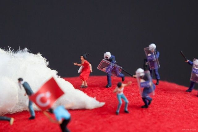 A Tiny Diorama of a Turkish Street Protest on a Fez by