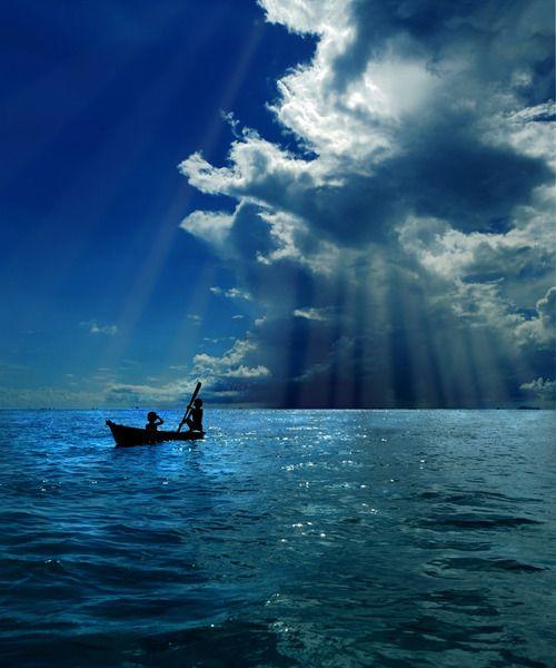 Heavenly open ocean water serenity. #ocean #sea #blue #water #boat #clouds