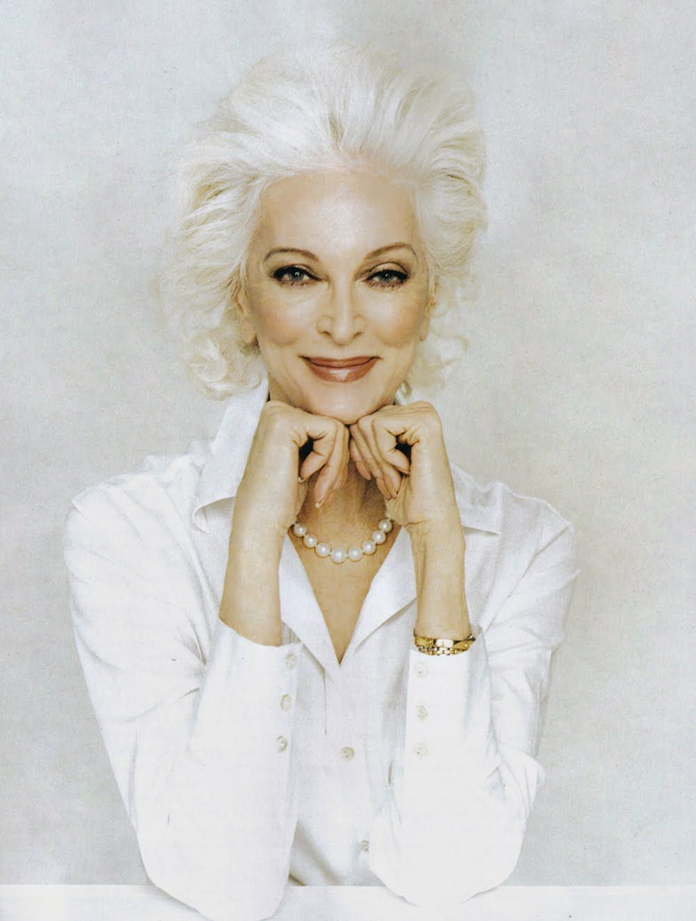 Carmen Dell'Orefice (born June 3, 1931) is 80 years old. She is the oldest model in the world modeling for the last 66 years, placing herself in the Guinness Book of World Records. Kudos to this beautiful woman!
