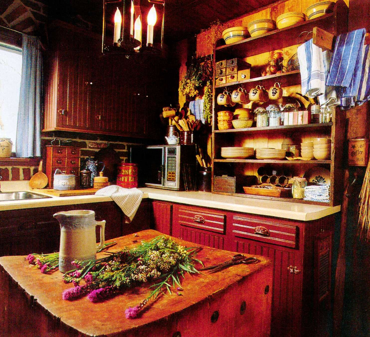 Love the red color on the cabinets. Not sure if that is ...