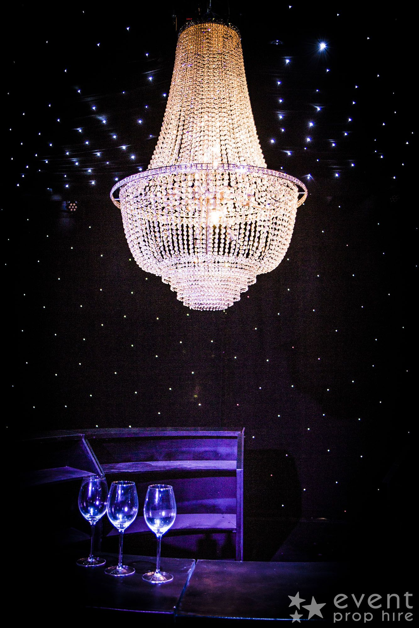 Crystal Chandelier available to hire (LE24)!  This large Crystal Chandelier would add more than a touch of class to any wedding, bling or glamorous themed event, adding light, sparkle and a sense of grandeur to any event!  Take a look at some more of our glamour themed props!