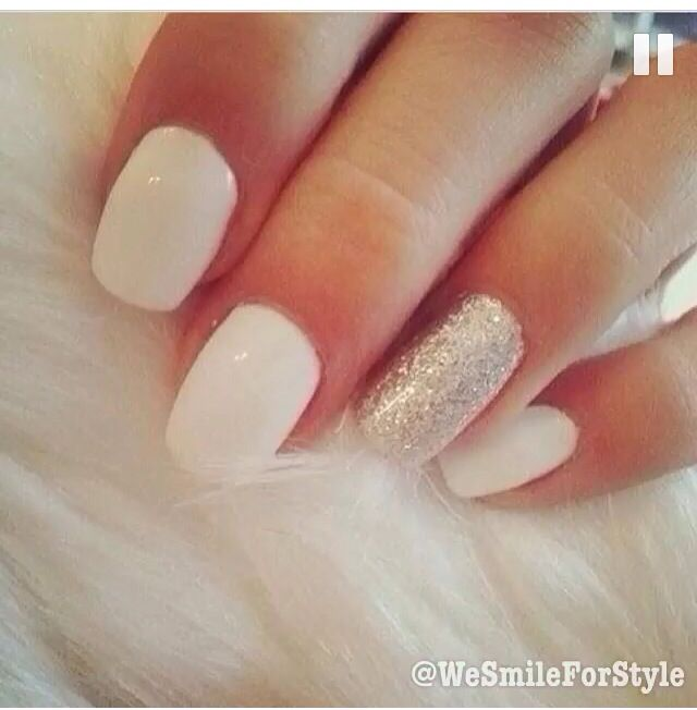 white nails with silver on the ring finger nails