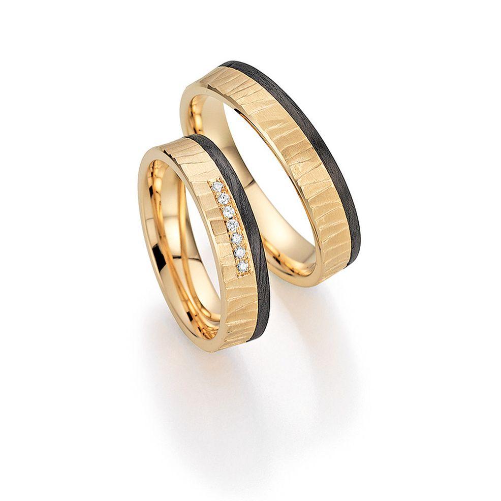 Alianzas oro 9k color albaricoque y fibra de carbono. #alianzas  #boda #alianzasdebodas