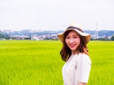 Japanese yound woman standing at the rice field. stock photo