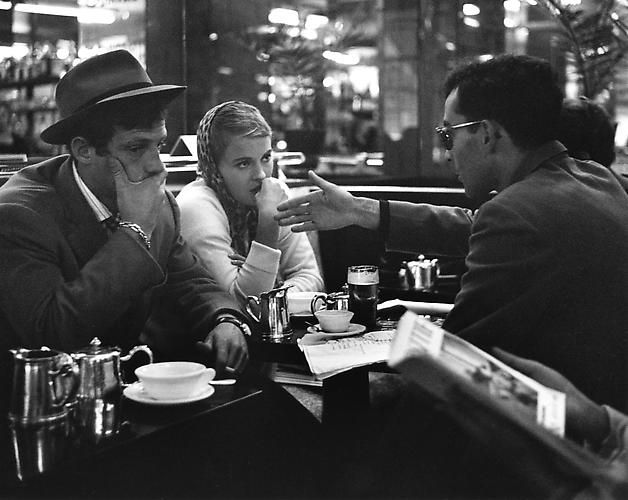 Heated debate between Godard and Jean Seberg about the scene, in the cafe on the Champs Elysees (A Bout De Souffle) 1959 - photo by Raymond Cauchetier